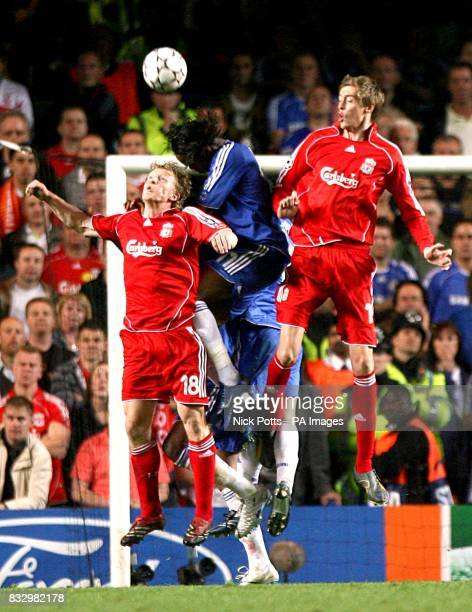 Liverpool's Dirk Kuyt and Peter Crouch and Chelsea's Didier Drogbl battle for the ball