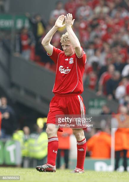 Liverpool's Dirk Kuyt applauds the fans after the final whistle
