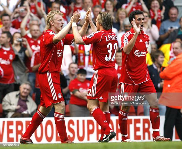 Liverpool's Dirk Kuyt celebrates after the opening goal of the match with team mates
