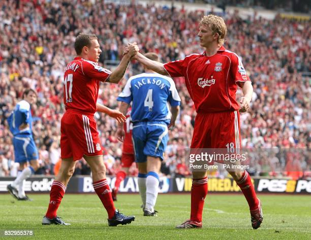 Liverpool's Dirk Kuyt celebrates scoring his second goal of the match with team mate Craig Bellamy