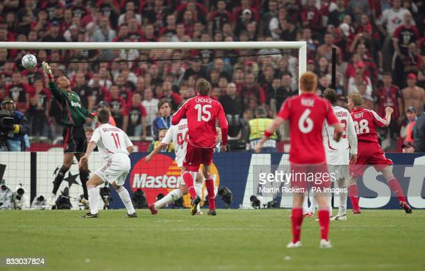 Liverpool's Dirk Kuyt scores the third goal late on in the game