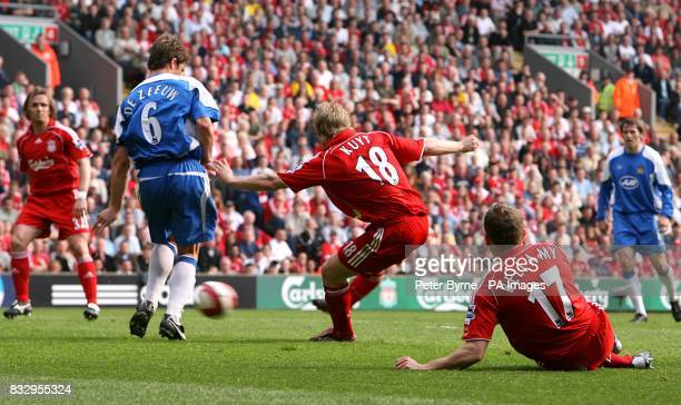 Liverpool's Dirk Kuyt slots home his second goal of the match