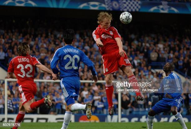 Liverpool's Dirk Kuyt wins the header