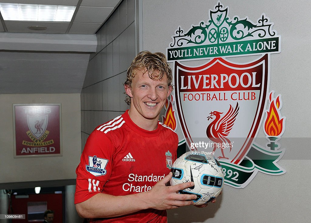 Liverpool's Dirk Kuyt with the hattrick ball at the end of Barclays Premier League match between Liverpool and Manchester United at Anfield on March...
