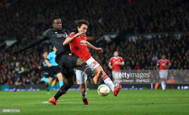 Liverpool's Divock Origi and Manchester United's Matteo Darmian battle for the ball