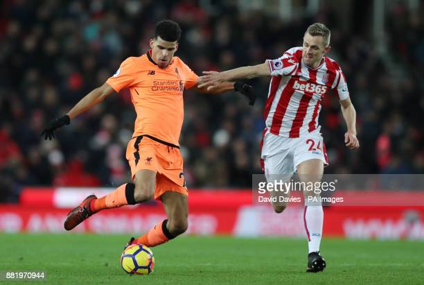 Liverpool's Dominic Solanke is challenged by Stoke City's Darren Fletcherduring the Premier League match at the bet365 Stadium Stoke