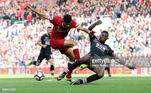 Liverpool's Dominic Solanke is tackled by Crystal Palace's Timothy FosuMensah during the Premier League match at Anfield Liverpool