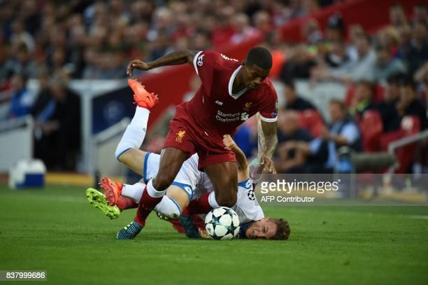 Liverpool's Dutch midfielder Georginio Wijnaldum and Hoffenheim's midfielder Dennis Geiger vie during the Champions League qualifier second leg match...