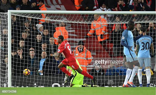 Liverpool's Dutch midfielder Georginio Wijnaldum celebrates after scoring the opening goal of the English Premier League football match between...