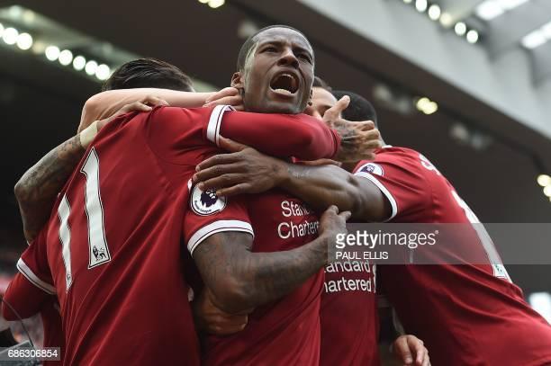 Liverpool's Dutch midfielder Georginio Wijnaldum celebrates scoring his team's first goal during the English Premier League football match between...