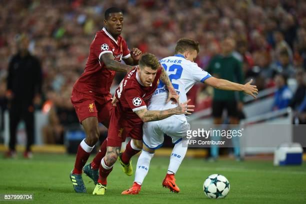Liverpool's Dutch midfielder Georginio Wijnaldum Liverpool's Spanish defender Alberto Moreno and Hoffenheim's midfielder Dennis Geiger vie during the...