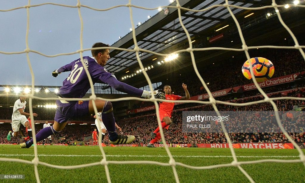 Liverpool's Dutch midfielder Georginio Wijnaldum (C) shoots past Watford's Romanian goalkeeper Costel Pantilimon (L) to score his team's sixth goal during the English Premier League football match between Liverpool and Watford at Anfield in Liverpool, north west England on November 6, 2016. / AFP / PAUL ELLIS / RESTRICTED TO EDITORIAL USE. No use with unauthorized audio, video, data, fixture lists, club/league logos or 'live' services. Online in-match use limited to 75 images, no video emulation. No use in betting, games or single club/league/player publications. /