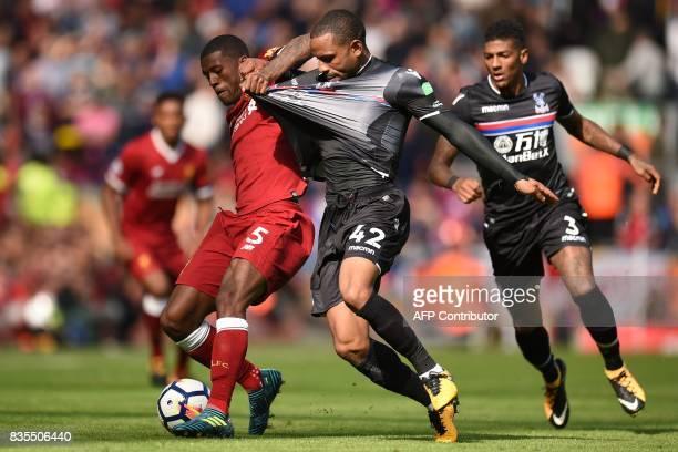 TOPSHOT Liverpool's Dutch midfielder Georginio Wijnaldum vies with Crystal Palace's English midfielder Jason Puncheon during the English Premier...
