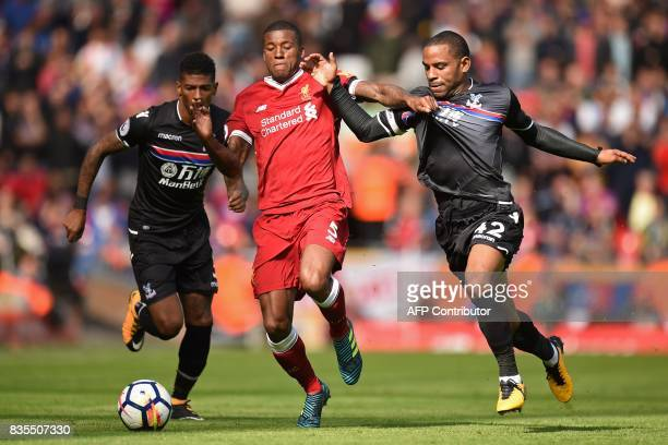 TOPSHOT Liverpool's Dutch midfielder Georginio Wijnaldum vies with Crystal Palace's English midfielder Jason Puncheon and Crystal Palace's Dutch...