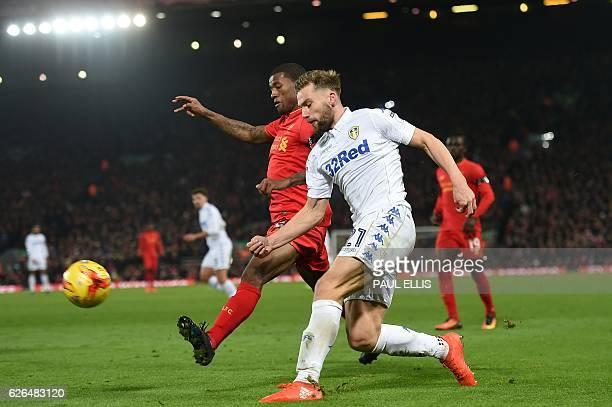 Liverpool's Dutch midfielder Georginio Wijnaldum vies with Leeds United's English defender Charlie Taylor during the EFL Cup quarterfinal football...