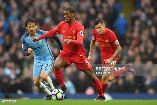 Liverpool's Dutch midfielder Georginio Wijnaldum vies with Manchester City's Spanish midfielder David Silva during the English Premier League...
