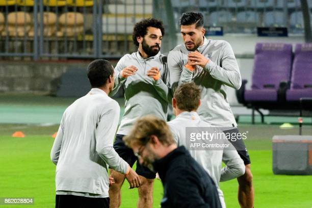 Liverpools Egyptian forward Mohamed Salah and German midfielder Emre Can warm up during a training session on the eve of the UEFA Champions League...