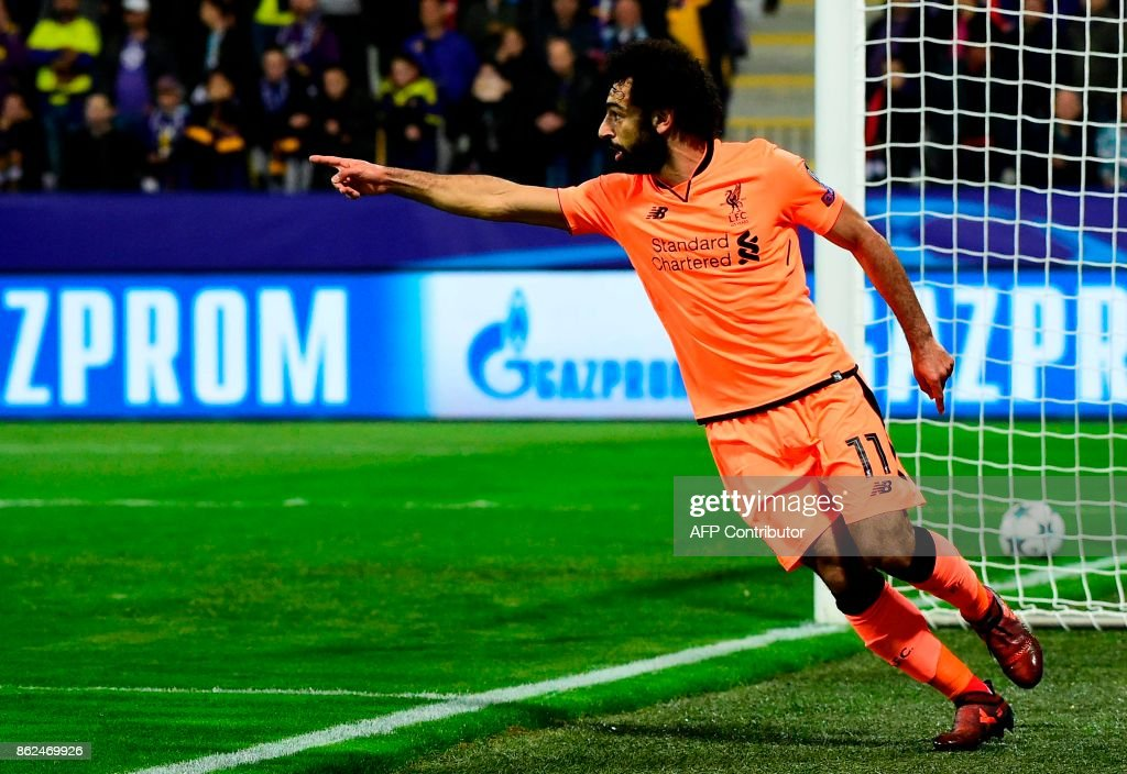 Liverpool's Egyptian forward Mohamed Salah celebrates after scoring a goal during the UEFA Champions League group E football match between NK Maribor and Liverpool at the Ljudski vrt Stadium, in Maribor, on October 17, 2017. / AFP PHOTO / Jure Makovec