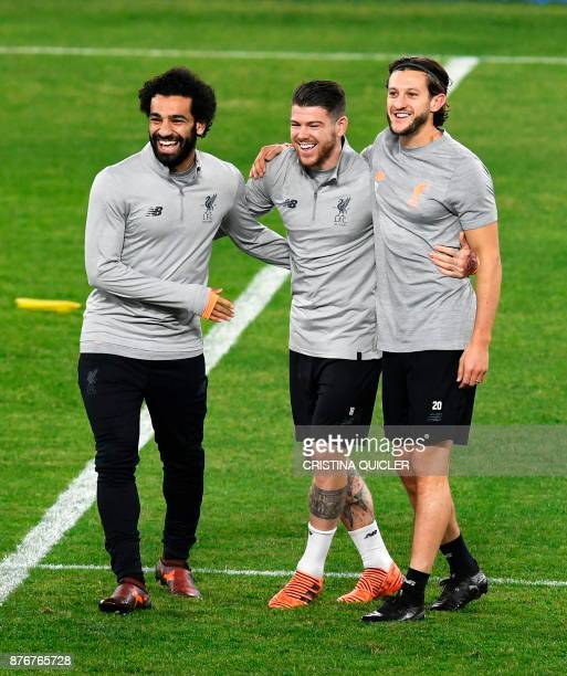 Liverpool's Egyptian forward Mohamed Salah laughs with Liverpool's Spanish defender Alberto Moreno and Liverpool's English midfielder Adam Lallana...