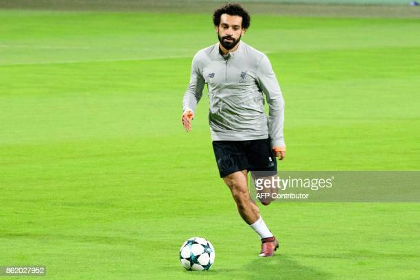 Liverpools Egyptian forward Mohamed Salah warms up during a training session on the eve of the UEFA Champions League Group E football match between...