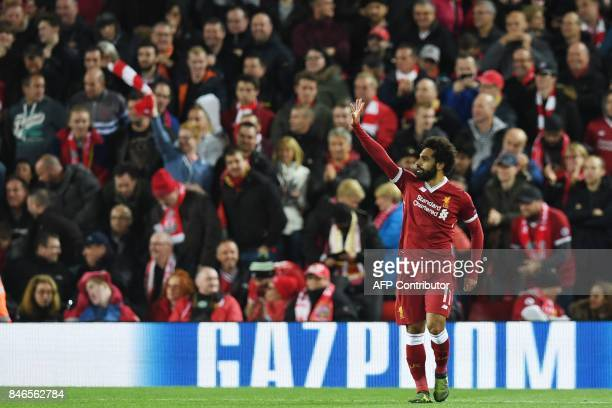 Liverpool's Egyptian midfielder Mohamed Salah celebrates after scoring during the UEFA Champions League Group E football match between Liverpool and...