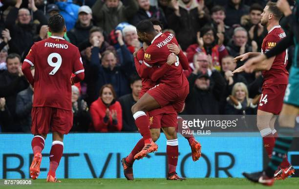Liverpool's Egyptian midfielder Mohamed Salah celebrates scoring his team's second goal with Liverpool's Dutch midfielder Georginio Wijnaldum during...