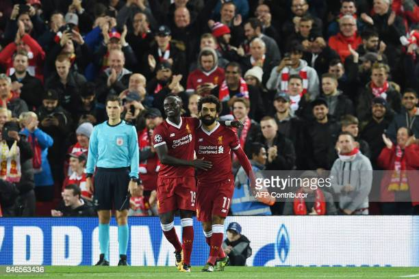Liverpool's Egyptian midfielder Mohamed Salah celebrates with Liverpool's Senegalese midfielder Sadio Mane after scoring during the UEFA Champions...