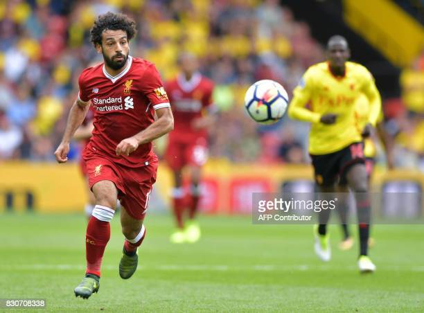 Liverpool's Egyptian midfielder Mohamed Salah chases the ball during the English Premier League football match between Watford and Liverpool at...
