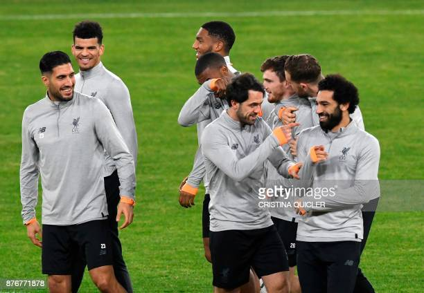Liverpool's Egyptian midfielder Mohamed Salah jokes with teammates Liverpool's German midfielder Emre Can and Liverpool's English striker Danny Ings...