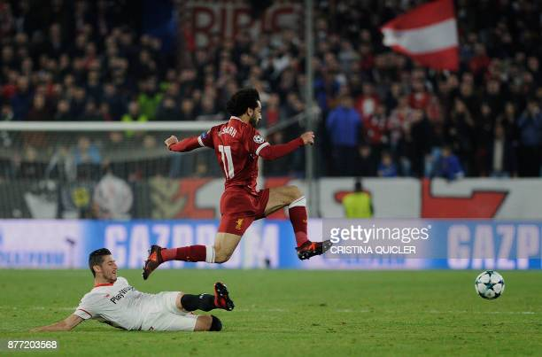 Liverpool's Egyptian midfielder Mohamed Salah jumps for the ball on November 21 2017 at the Ramon Sanchez Pizjuan stadium in Sevilla during the UEFA...