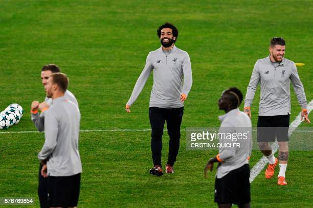 Liverpool's Egyptian midfielder Mohamed Salah laughs during a training session at Ramon Sanchez Pizjuan stadium in Sevilla on November 20 2017 on the...