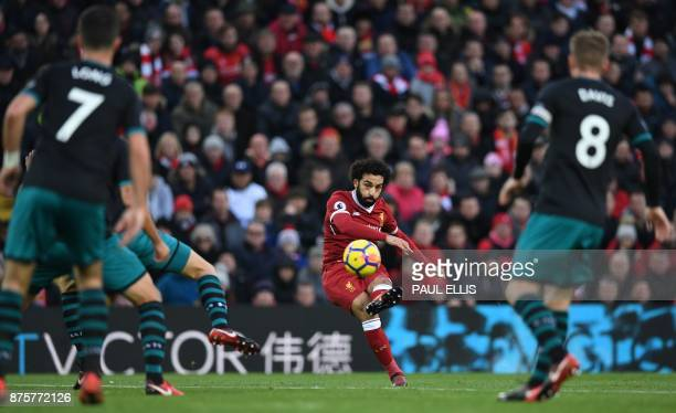 TOPSHOT Liverpool's Egyptian midfielder Mohamed Salah scores the opening goal during the English Premier League football match between Liverpool and...
