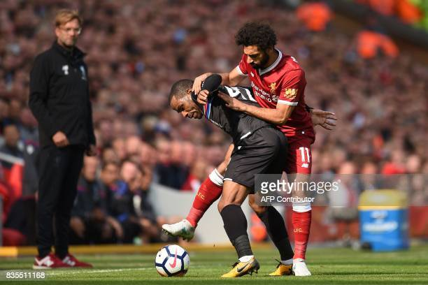 Liverpool's Egyptian midfielder Mohamed Salah vies with Crystal Palace's English midfielder Jason Puncheon during the English Premier League football...