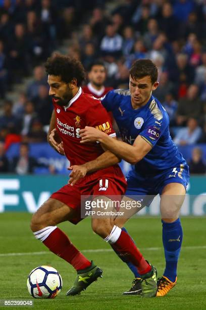 Liverpool's Egyptian midfielder Mohamed Salah vies with Leicester City's English defender Ben Chilwell during the English Premier League football...
