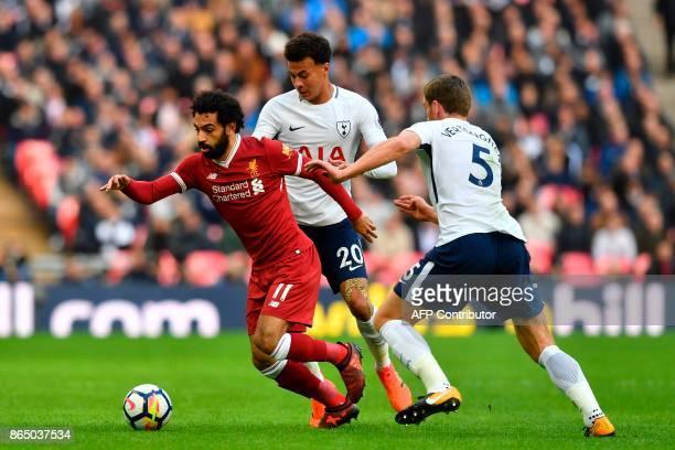 Liverpool's Egyptian midfielder Mohamed Salah vies with Tottenham Hotspur's English midfielder Dele Alli and Tottenham Hotspur's Belgian defender Jan...