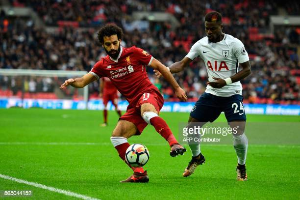 Liverpool's Egyptian midfielder Mohamed Salah vies with Tottenham Hotspur's Ivorian defender Serge Aurier during the English Premier League football...
