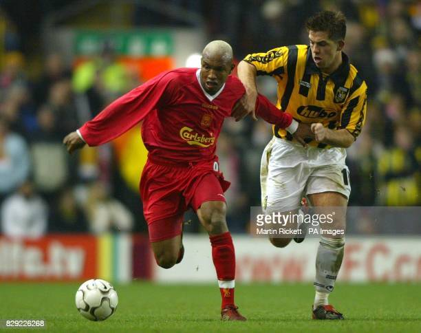 Liverpool's ElHadji Diouf screens the ball from Vitesse Arnham's Theo Janssen during the UEFA Cup 3rd Round 2nd Leg match at Anfield Liverpool THIS...