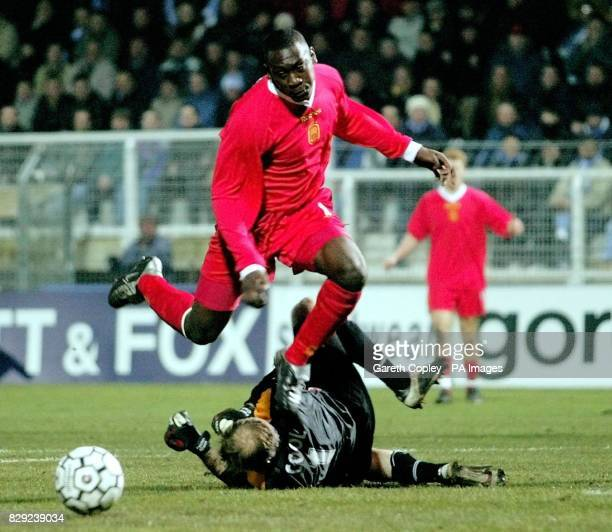 Liverpool's Emile Heskey falls over Auxerre goalkeeper Fabien Cool during the UEFA Cup fourth round first leg match at Abbe Deschamps Stadium Auxerre...