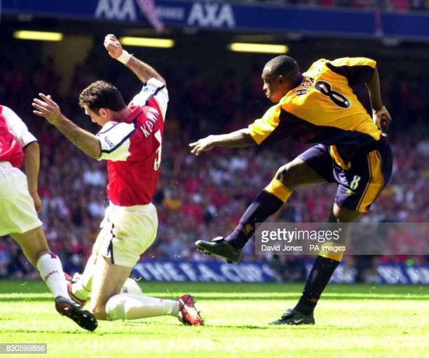 LEAGUE Liverpool's Emile Heskey takes a shot on goal but is blocked by Arsenal's Martin Keown during today's FA Cup Final at the Millennium Stadium...