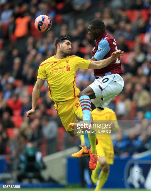 Liverpool's Emre Can and Aston Villa's Christian Benteke battle for the ball in the air