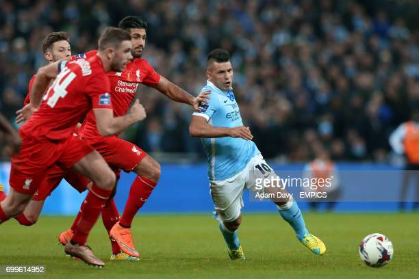 Liverpool's Emre Can and Manchester City's Sergio Aguero battle for the ball