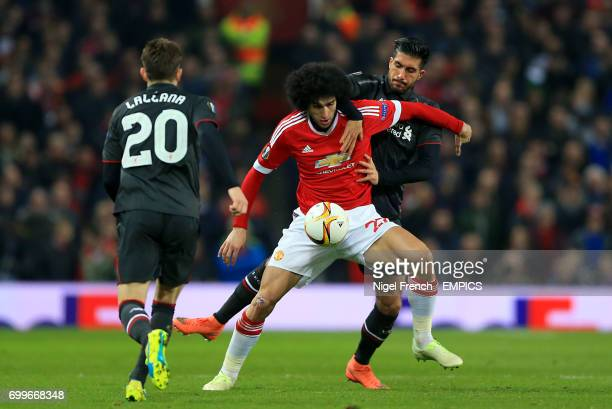 Liverpool's Emre Can and Manchester United's Marouane Fellaini battle for the ball