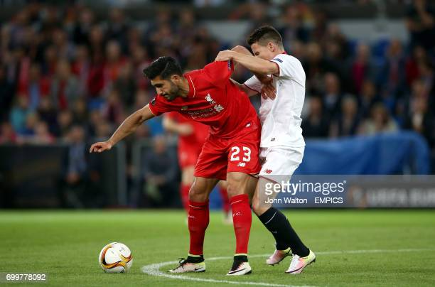 Liverpool's Emre Can and Sevilla's Kevin Gameiro battle for the ball