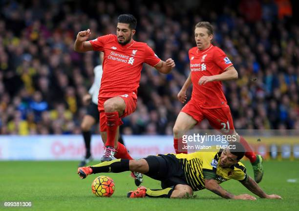 Liverpool's Emre Can and Watford's Troy Deeney battle for the ball