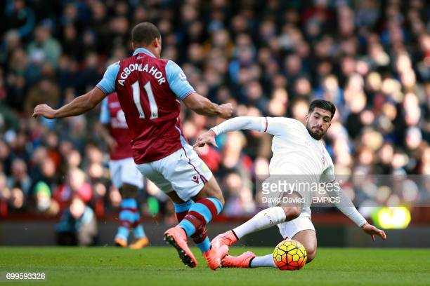 Liverpool's Emre Can Aston Villa's Gabriel Agbonlahor battle for the ball