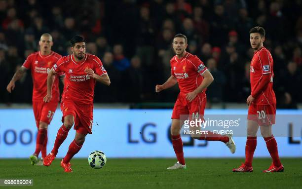Liverpool's Emre Can controls the ball watched by Liverpool's Jordan Henderson Liverpool's Adam Lallana and Liverpool's Martin Skrtel