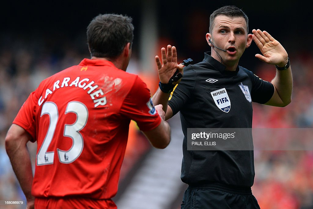 "Liverpool's English defender Jamie Carragher (L) argues with referee Michael Oliver during the English Premier League football match between Liverpool and Everton at the Anfield stadium in Liverpool, northwest England, on May 5, 2013. USE. No use with unauthorized audio, video, data, fixture lists, club/league logos or ""live"" services. Online in-match use limited to 45 images, no video emulation. No use in betting, games or single club/league/player publications"