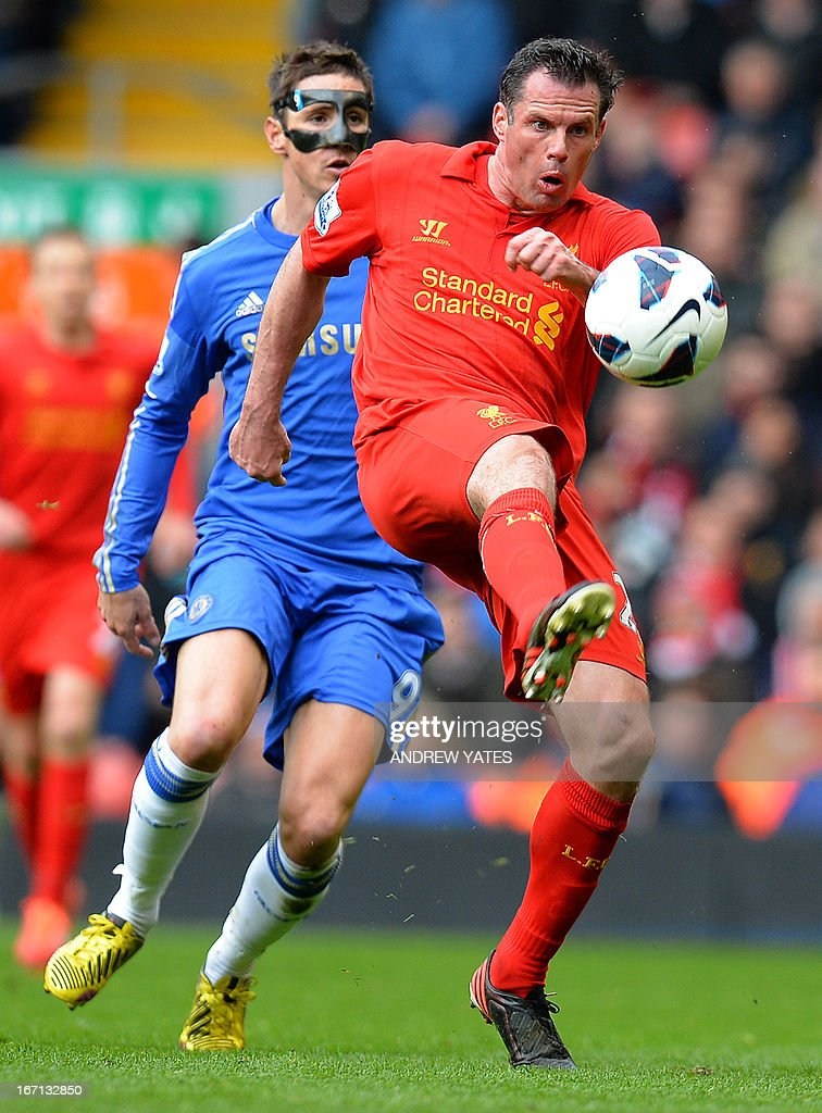 "Liverpool's English defender Jamie Carragher (R) clears in front of Chelsea's Spanish striker Fernando Torres (L) during the English Premier League football match between Liverpool and Chelsea at the Anfield stadium in Liverpool, northwest England, on April 21, 2013. USE. No use with unauthorized audio, video, data, fixture lists, club/league logos or ""live"" services. Online in-match use limited to 45 images, no video emulation. No use in betting, games or single club/league/player publications."