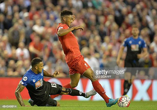 Liverpool's English defender Joe Gomez is challenged by Bournemouth's English striker Callum Wilson during the English Premier League football match...