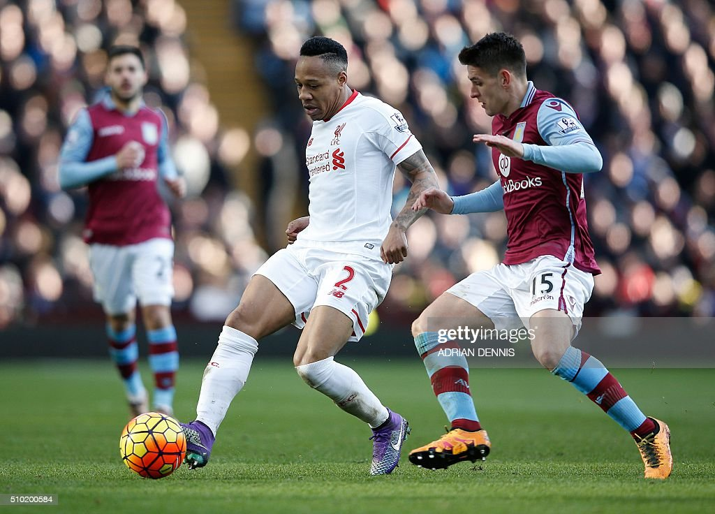 Liverpool's English defender Nathaniel Clyne (L) vies with Aston Villa's English midfielder Ashley Westwood during the English Premier League football match between Aston Villa and Liverpool at Villa Park in Birmingham, central England on February 14, 2016. Liverpool won the match 6-0. / AFP / ADRIAN DENNIS / RESTRICTED TO EDITORIAL USE. No use with unauthorized audio, video, data, fixture lists, club/league logos or 'live' services. Online in-match use limited to 75 images, no video emulation. No use in betting, games or single club/league/player publications. /